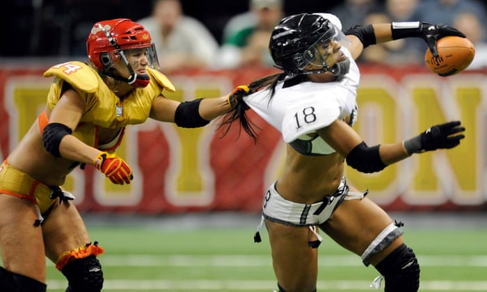 Woman putting football in pussy